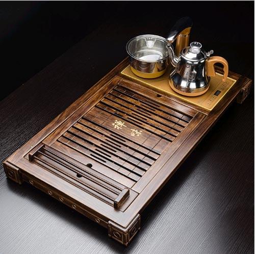 Bộ khay trà gỗ mun - Mã KTG10 được thiết kế có khu để bếp từ đun nước, khay gác chén. Trọng lượng 5kg
